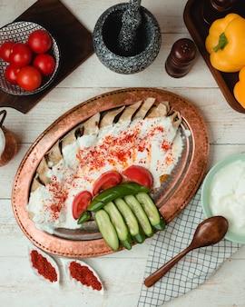 Doner in lavash with plain yogurt, tomatoes, cucumbers, and chili pepper