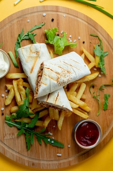 Doner wrapped in lavash and fries