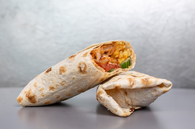 Doners in pita bread with chicken filling and vegetables.