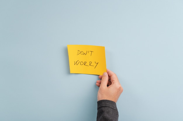 Dont worry sign on yellow post it paper