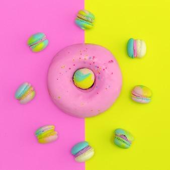 컬러 배경에 도넛과 마카롱입니다. 평평한 음식 바닐라 캔디 디자인