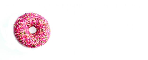 Donut in a pink glaze with multi-colored sprinkle on white.