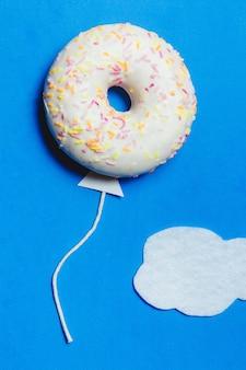 Donut in shape of balloon in sky