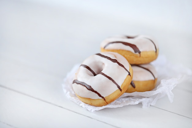 Donut. white striped donuts on a light wooden
