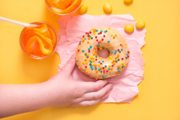 Donut on yellow background. top view. copy space.