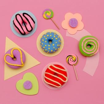 ドーナツとキャンディーラバーセット。フラットレイスイートミニマルピンクアート