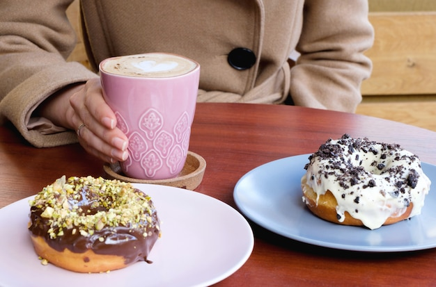 Donuts of chocolate and coffee