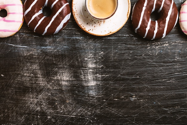 Donuts and coffee on black