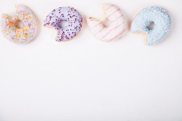 Donuts in colored glazes .pastries,dessert.