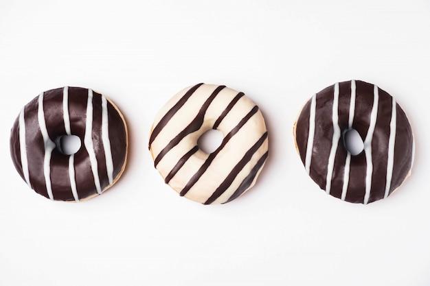 Donuts glazed with white and dark chocolate