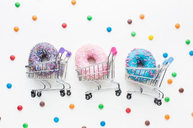Donuts in shopping carts set