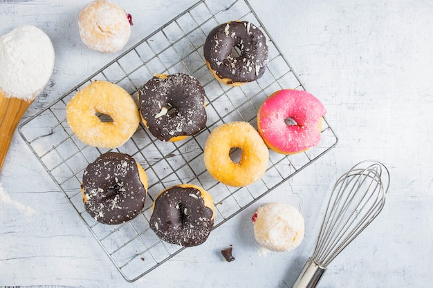 Donuts on a white wood background