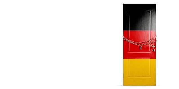 ドイツの国旗で着色されたドア、チェーンでロック。コロナウイルス、covid拡散中の国の封鎖。医学とヘルスケアの概念。世界的な流行、検疫。コピースペース。
