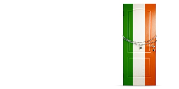 Door colored in ireland national flag, locking with chain. countries lockdown during coronavirus, covid spreading. concept of medicine and healthcare. worldwide epidemic, quarantine. copyspace.