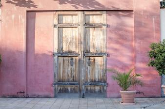 Door on red wall.