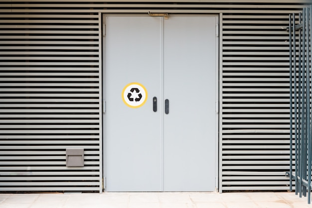 A door of a residential building to deposit recyclable garbage