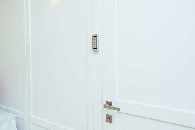 Door with coded lock in the middle of the room in white