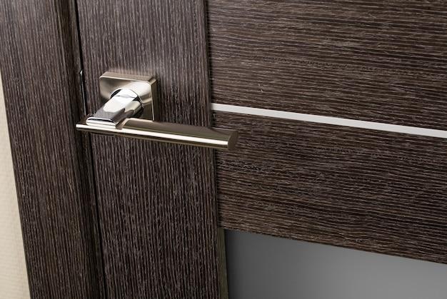 Door with a metal handle