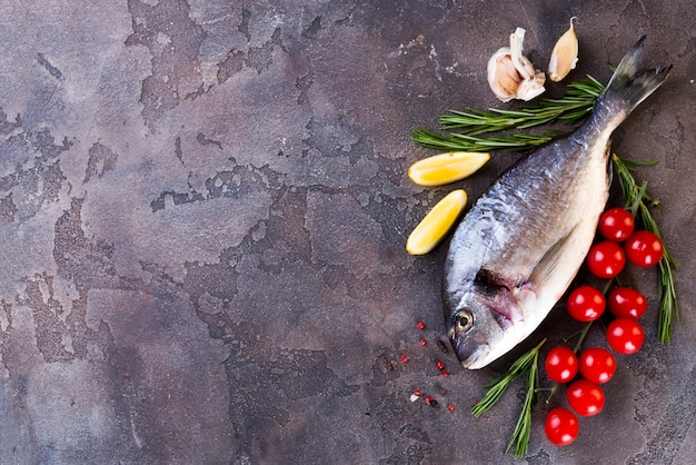 Dorado fish on a granite board