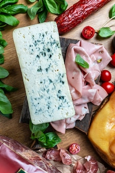 Dorblu stilton dairy product, blue cheese roquefort gorgonzola made from goat sheep or cow milk roquefort, cambozola, food recipe background