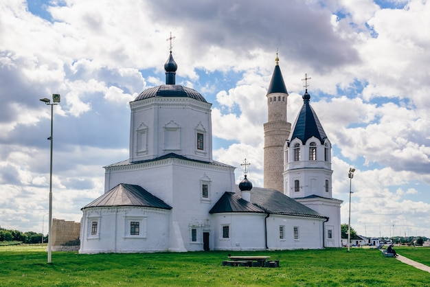 Dormition church and big minaret of cathedral mosque on table. bolghar, russia.
