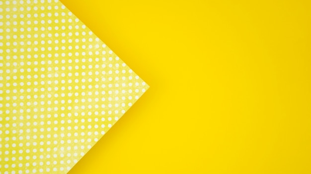 Dots on paper and yellow copy space background