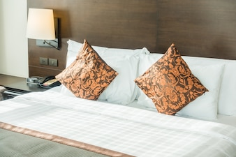 Double bed with orange cushions