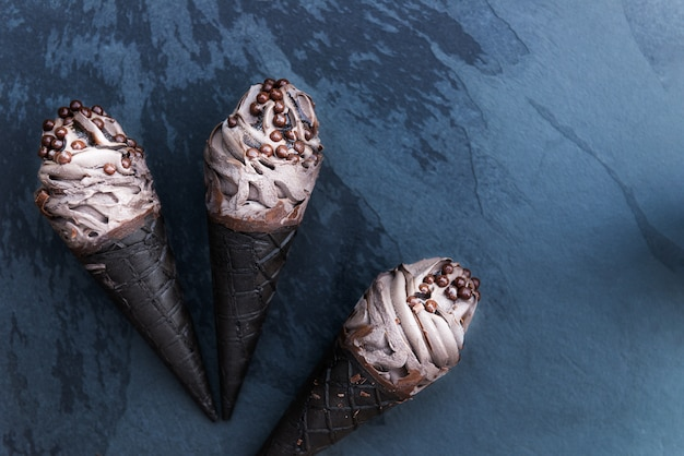 Double chocolate ice creams with black waffle cones