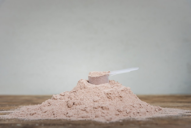 Double chocolate whey protein powder scoop nutrition healthy food bodybuilding.