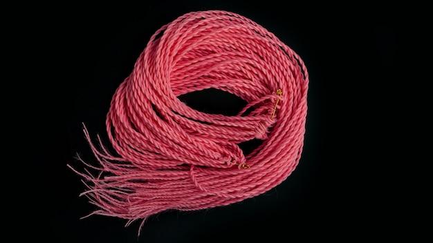 Двусторонние синтетические косы и розовые дреды на черном