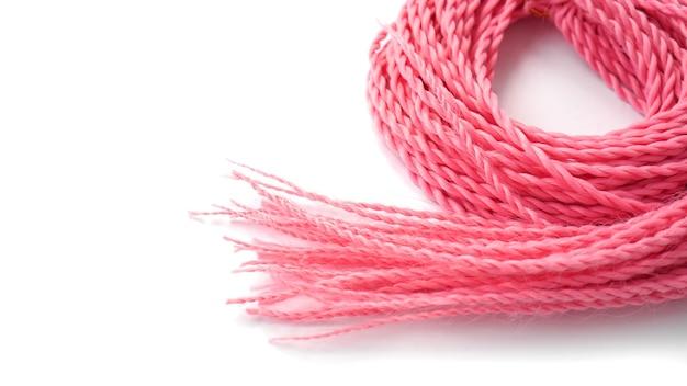 Двусторонние синтетические косы и розовые дреды на белом