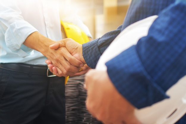 Double exposure of business handshake successful teamwork and partnership concept.shake hands business agreement