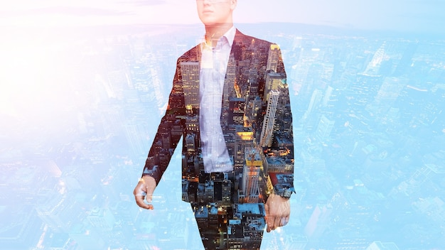 Double exposure of businessman and city on the background