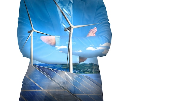 Double exposure graphic of business people working over wind turbine farm and green renewable energy worker interface