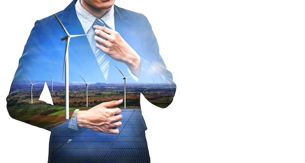 풍력 터빈 농장과 녹색 재생 가능 에너지 작업자 인터페이스를 통해 일하는 사업 사람들의 이중 노출 그래픽. 대체 에너지에 의한 지속 가능성 개발의 개념.