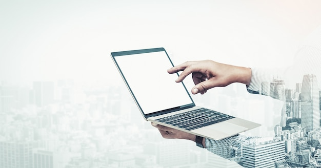 Double exposure image of businessman use computer
