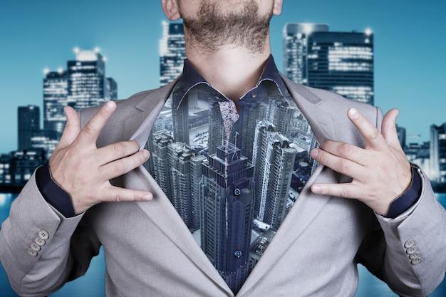 현대 도시 배경 사업가의 이중 노출 이미지. 비즈니스 및 통신 기술의 미래 개념입니다. 고품질 사진