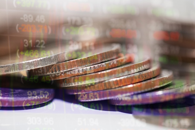 Double exposure rows of coins of cash,money, dollar on the table