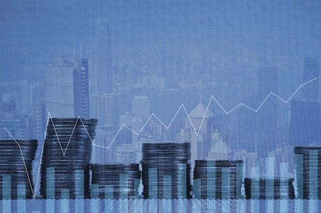 Double exposure stack of coin with financial graph city background
