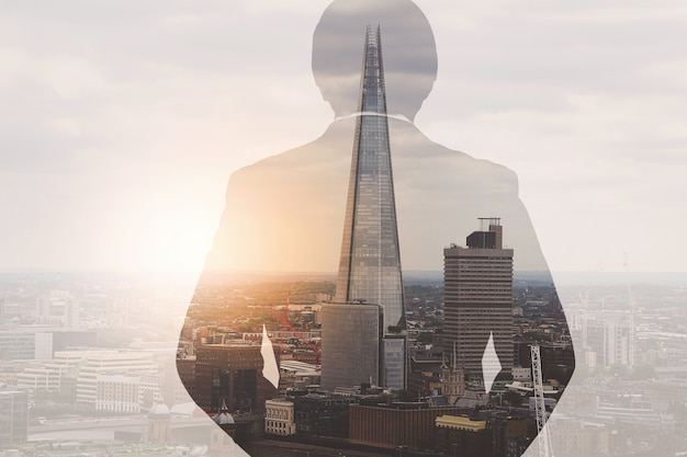 Double exposure of success businessman using smart phone with london building,filter effect