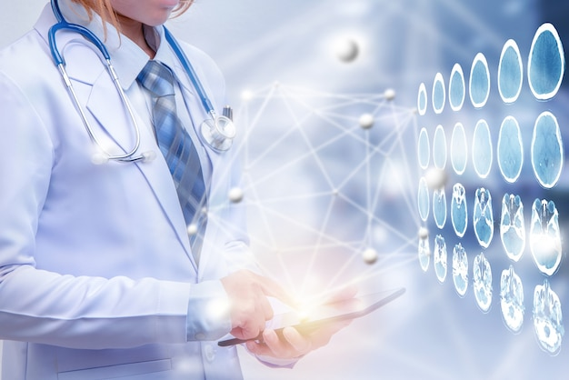 Double exposure woman doctor holding tablet or smart phone modern medical concept