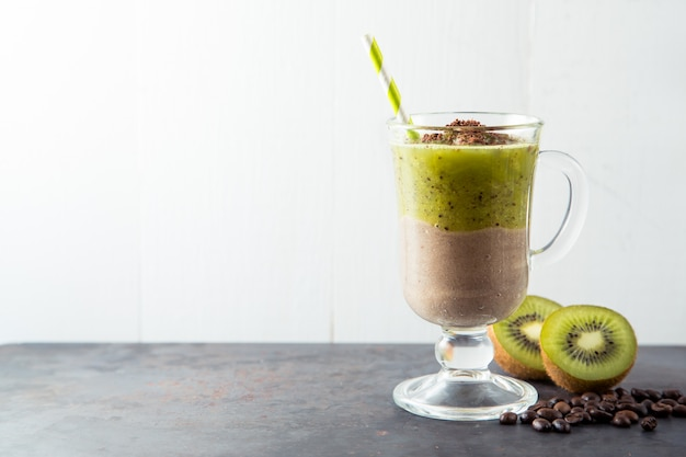 Double layer green smoothie of chocolate and kiwi