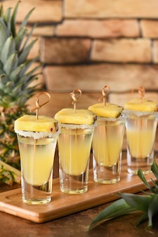 Double shots of tropical tequila with pineapple juice  party for cinco de mayo