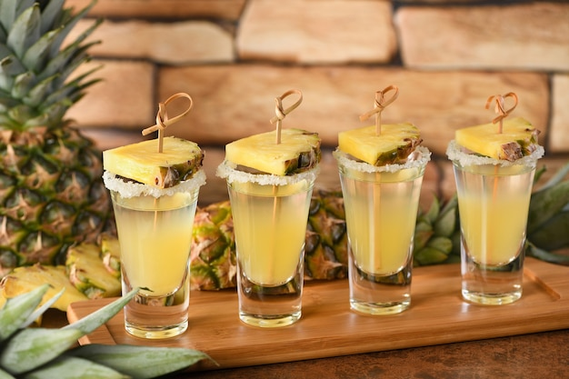 Double shots of tropical tequila with pineapple juice