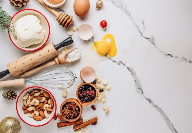 Dough ingredients and decorations for christmas cake