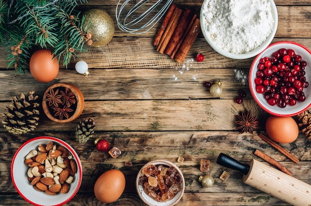 Dough ingredients and decorations on wooden table