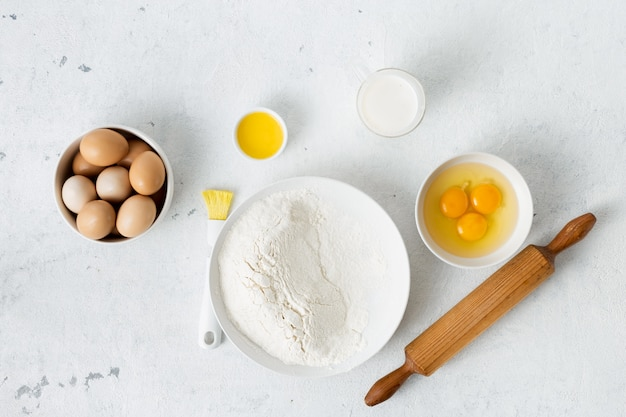 Dough ingredients on a white background top view