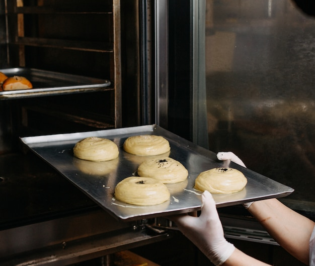 Dough qogal meal pastry in process of making dough sweet bun inside silver oven-tray