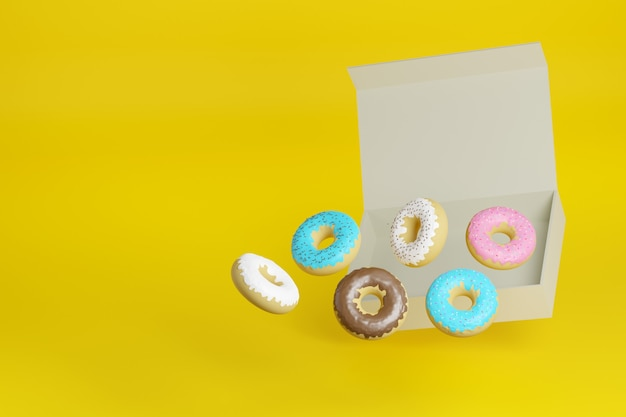 Пончики выходят из коробки на желтой поверхности