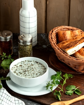 Dovga soup and basket with herbs